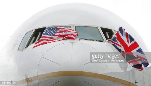 British and US flags fly from the cockpit windows of Continental Airlines flight CO28 after it arrived at London's Heathrow Airport from New York...
