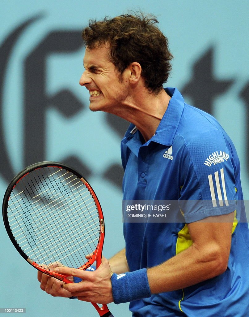 British Andy Murray celebrates after winning against Juan Ignacio Chela of Argentina during their match of the Madrid Masters on May 12, 2010 at the Caja Magic sports complex in Madrid.