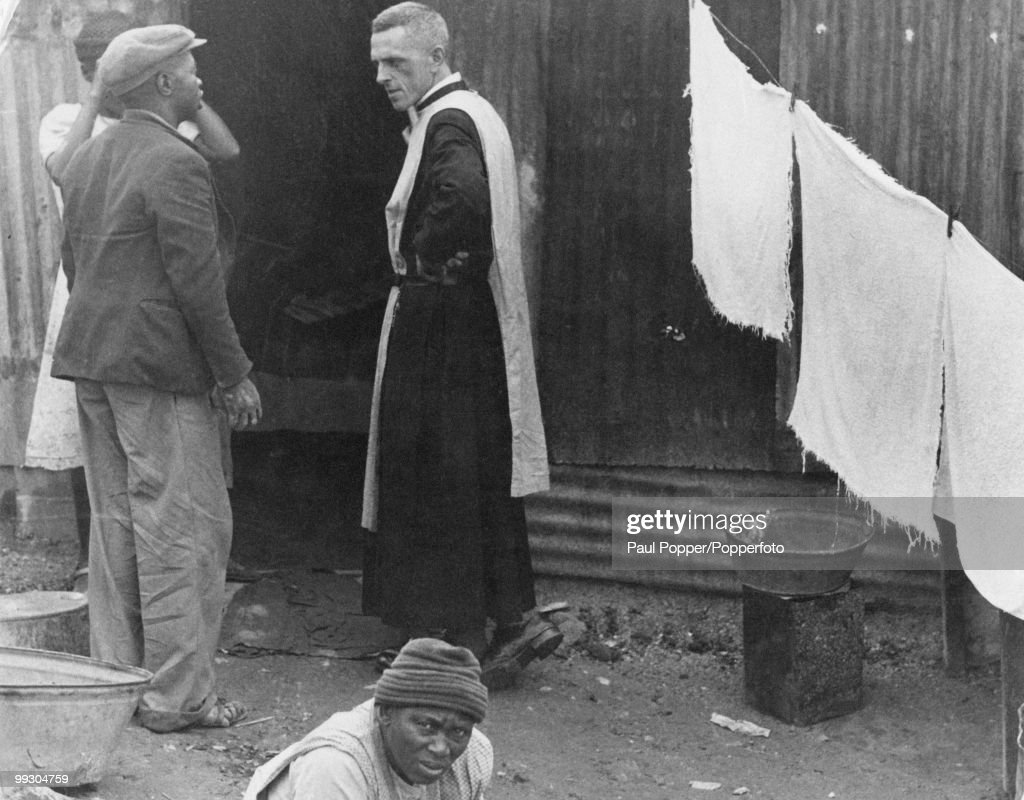 British Anglican priest and antiApartheid activist Trevor Huddleston talking to residents of a slum area in Newclare Johannesburg South Africa 1956...