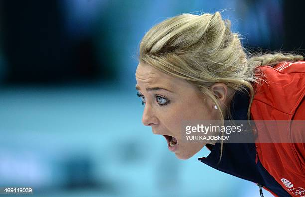 British Anna Sloan shouts as she throws the stone during the 2014 Sochi winter Olympics women's curling round robin session 8 match South Korea...