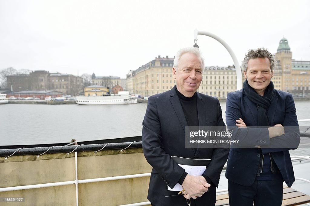 British architect David Chipperfield (L) and German architect Christoph Felger of David Chipperfield Architects Berlin pose at Nybrokajen/Blasieholmen, after the Nobel Foundation annouced David Chipperfield Architects as winners of the Nobel Center architectural competition, in Stockholm, Sweden, on April 9, 2014. The Nobel Foundation unveiled the Chipperfield plans as the winning design for the NobelCenter building that will give the world's most prestigious prize a home for the first time in its 100-plus-year history. The Foundation hopes to inaugurate the 25,000-square-metre (269,000-square-feet) building in 2018, when it is expected to house nearly all its activities, including the Nobel Prize ceremony and the Nobel museum. AFP PHOTO / TT NEWS AGENCY / HENRIK MONTGOMERY / SWEDEN OUT