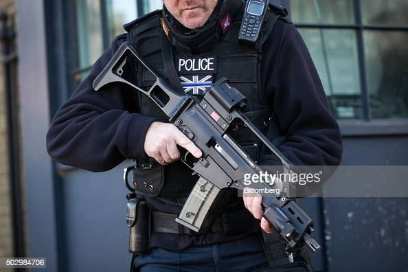 A British armed police officer stands on guard at Horse Guards Parade in London UK on Thursday Dec 31 2015 Around 3000 police officers will be on...