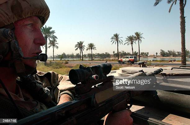 British Army 1st Battallion King's Regiment Corporal Paul Archer from Blackpool England rides top cover during a convoy to the IraqIran border...