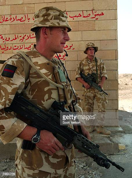 British Army 1st Battallion King's Regiment Kingsman John Sealey from Liverpool England and Kingsman Scott Manning also from Liverpool stand watch at...