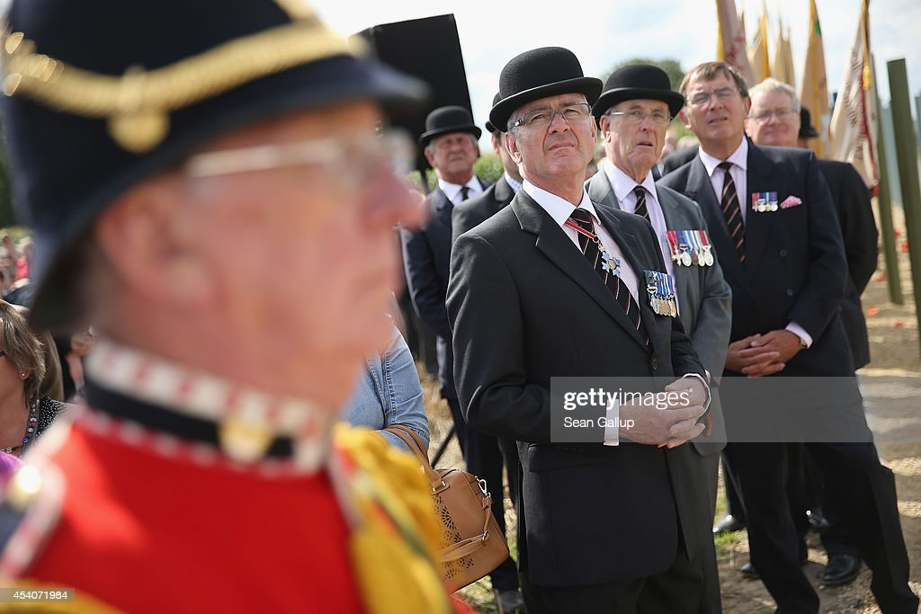 A British Army bugle player and Cheshire Regiment veteran officers attend the inauguration ceremony of a monument to honour members of the British Cheshire Regiment and other soldiers who died fighting the German Army exactly 100 years before at the same site during World War I on August 24, 2014 in Audregnies, Belgium. Of the 25 officers and 925 men of the 1st Battalion, Cheshire Regiment who fought that day on August 24, 1914, only a total of 207 would survive after two messengers with instructions for the unit to retreat failed to make it through. The battle came on the heals of the Battle of Mons the day before, which was the first major engagmement between British and German forces in the war. The British, French and Belgian armies were forced to continue their retreat until weeks later, when only a short distance from Paris they managed to reverse the tide of the war and push the Germans back north.