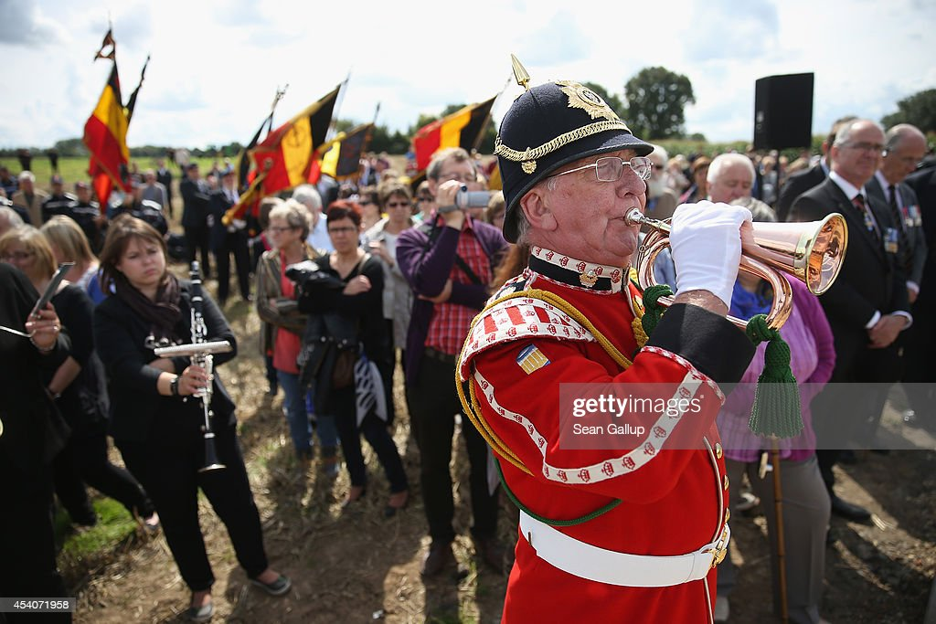 A British Army bugle player, locals and Cheshire Regiment veterans (R) attend the inauguration ceremony of a monument to honour members of the British Cheshire Regiment and other soldiers who died fighting the German Army exactly 100 years before at the same site during World War I on August 24, 2014 in Audregnies, Belgium. Of the 25 officers and 925 men of the 1st Battalion, Cheshire Regiment who fought that day on August 24, 1914, only a total of 207 would survive after two messengers with instructions for the unit to retreat failed to make it through. The battle came on the heals of the Battle of Mons the day before, which was the first major engagmement between British and German forces in the war. The British, French and Belgian armies were forced to continue their retreat until weeks later, when only a short distance from Paris they managed to reverse the tide of the war and push the Germans back north.