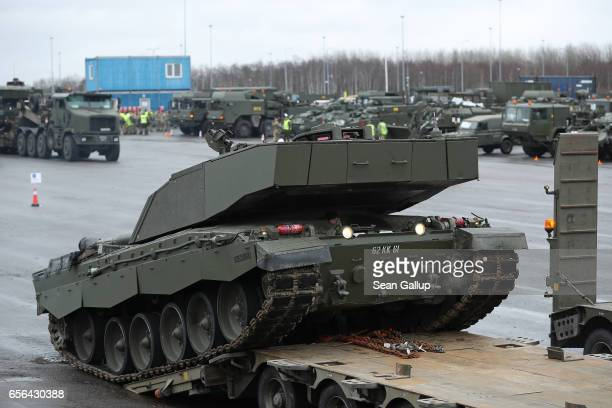 British Army Challenger 2 tank of the 5th Battalion The Rifles drives backwards onto a truck trailer for transport after the tank and other heavy...