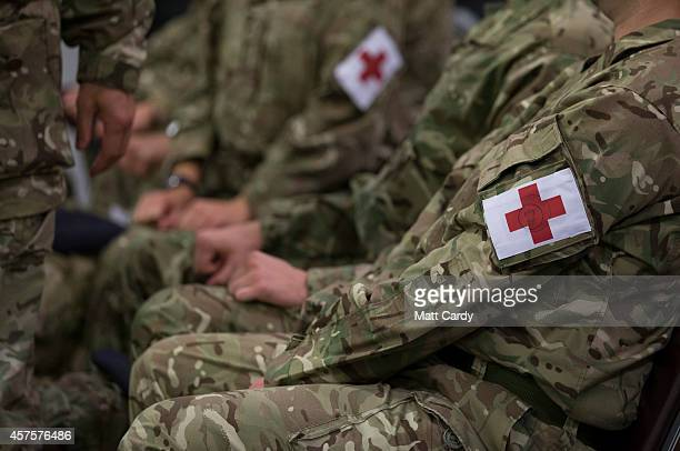 British Army medics sit in the departure lounge as they wait to board an aircraft flying to Sierra Leone at RAF Brize Norton on October 21 2014 in...