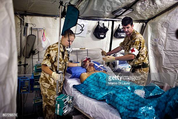 British Army nurses attend to British Army soldier Alexander Harrison from the Grenadier Guards Regiment attached to the Royal Anglion Regiment at...