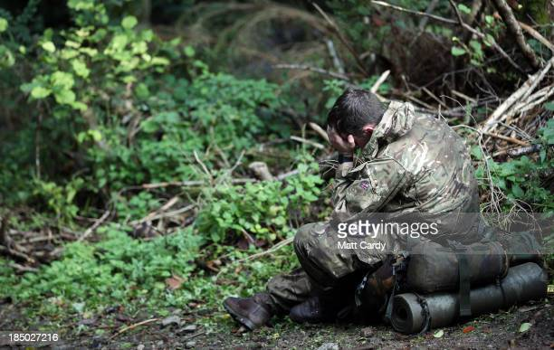 British Army officer cadet from the Royal Military Academy Sandhurst takes a break before begining a command task at a checkpoint as he takes part in...