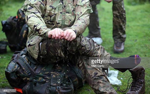 British Army officer cadet from the Royal Military Academy Sandhurst tries to dry his socks as he takes a break before begining a command task at a...