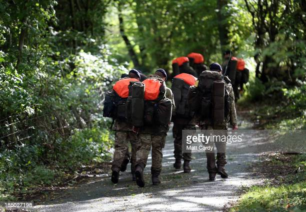 British Army officer cadets from the Royal Military Academy Sandhurst march from a checkpoint as they take part in Exercise Long Reach in the Brecon...