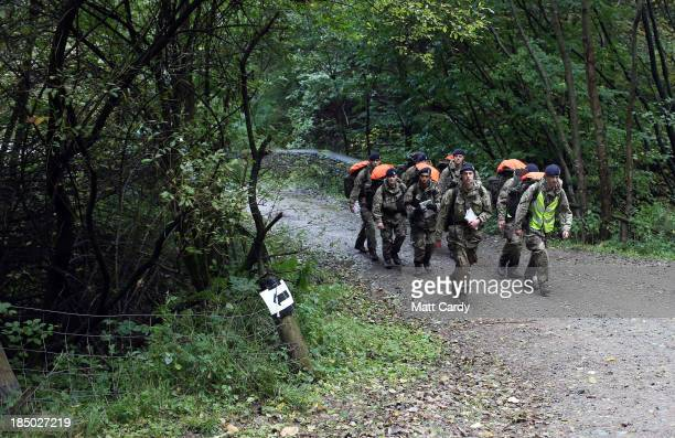 British Army officer cadets from the Royal Military Academy Sandhurst march towards a checkpoint as they take part in Exercise Long Reach in the...