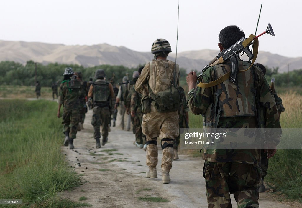 British Army Officer, Captain Alex Corbet Burcher from the 1st Battalion Welsh Guards Regiment,attached to the Inkerman Company, 1st Battalion Grenadier Guards Regiment patrols with ANA (Afghan National Army) Soldiers his area of operation during 'Lastay Kulang' Operation' on June 1, 2007 in Sangin Valley, Helmand Province, Afghanistan. British troops from The Inkerman Company, 1st Battalion Grenadier Guards, part of ISAF Task Force Helmand, are mentoring the Afghan National Army while conducting security operations on behalf of the Government of Afghanistan in Helmand Province.