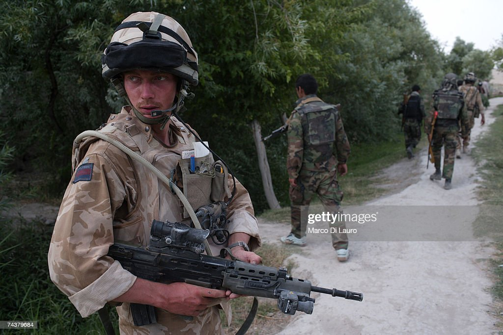 British Army Officer, Second Lieutenant Alex Forster from the The Inkerman Company, 1st Battalion Grenadier Guards Regiment patrol is area of operation with ANA (Afghan National Army) soldiers during 'Lastay Kulang' Operation' on June 1, 2007 in Sangin Valley, Helmand Province, Afghanistan. British troops from The Inkerman Company, 1st Battalion Grenadier Guards, part of ISAF Task Force Helmand, are mentoring the Afghan National Army while conducting security operations on behalf of the Government of Afghanistan in Helmand Province.