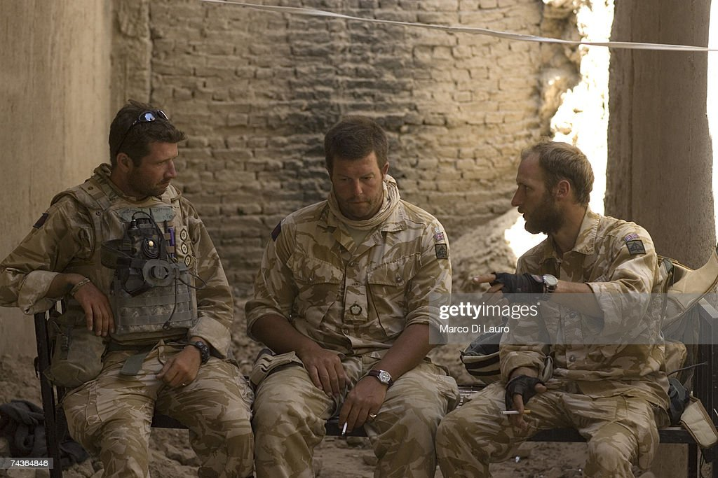 British Army Officers, Captain Alex Corbet Burcher from the 1st Battalion Welsh Guards Regiment, Major Marcus Elliot, Commander of the Inkerman Company, 1st Battalion Grenadier Guards Regiment and Captain Edward Janvrin from the 2nd Battalion of the Royal Gurkha Rifles Regiment talk to each others during 'Lastay Kulang' Operation' in Tangiers Patrol Base(PB) on May 29, 2007 in Sangin Valley, Helmand Province, Afghanistan. British troops from The Inkerman Company, 1st Battalion Grenadier Guards, part of ISAF Task Force Helmand, are mentoring the Afghan National Army while conducting security operations on behalf of the Government of Afghanistan in Helmand Province.