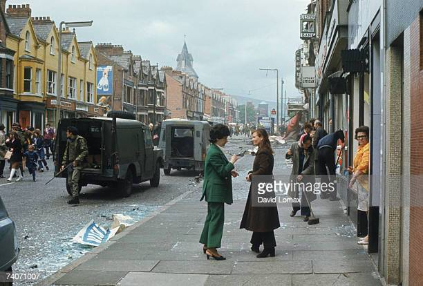 A British Army patrol arrives in the aftermath of a bomb blast in Belfast Northern Ireland circa 1972