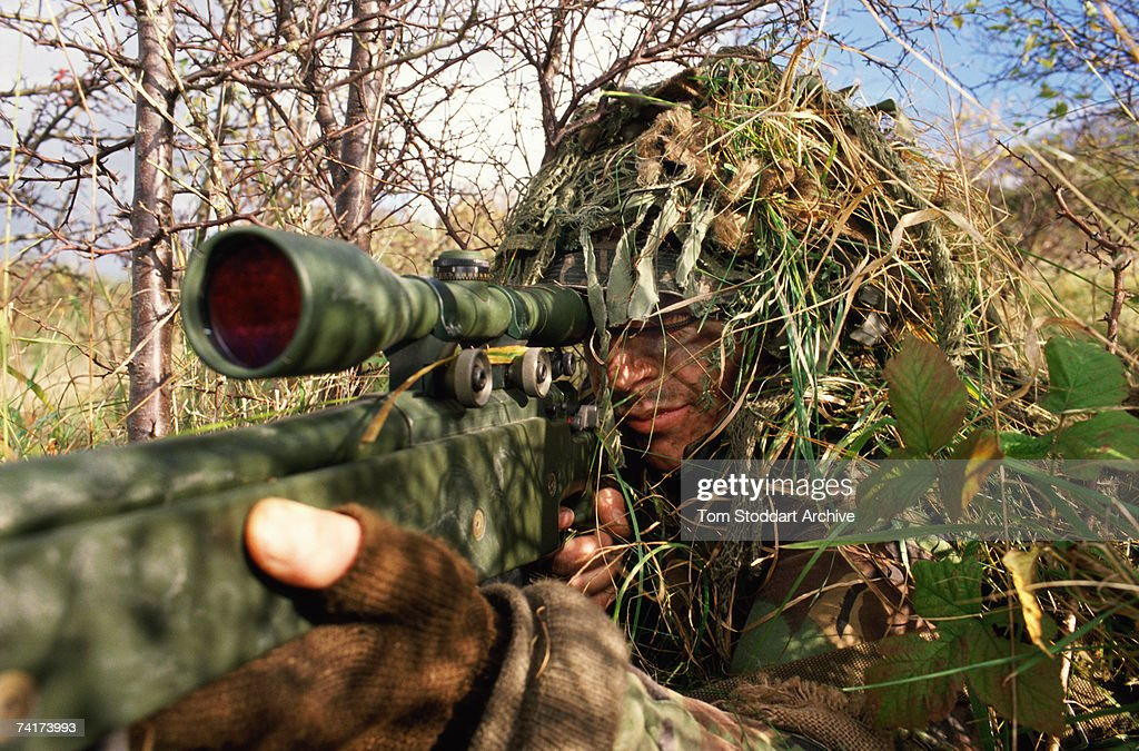 A British army sniper camouflaged during training in concealment techniques, May 1990.