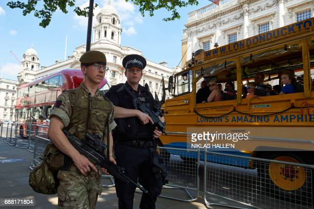 A British army soldier and a police officer patrol together near to Horse Guards Parade in central London on May 25 after Operation Temperer was put...