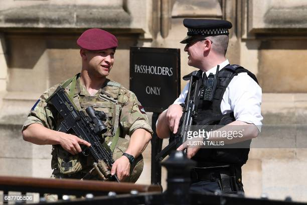 A British Army soldier from the Parachute Regiment stands on duty with an armed police officer outside of the Houses of Parliament in central London...