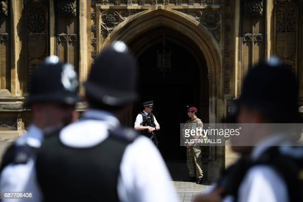 British Army soldier from the Parachute Regiment stands on duty with an armed police officer outside of the Houses of Parliament in central London on...