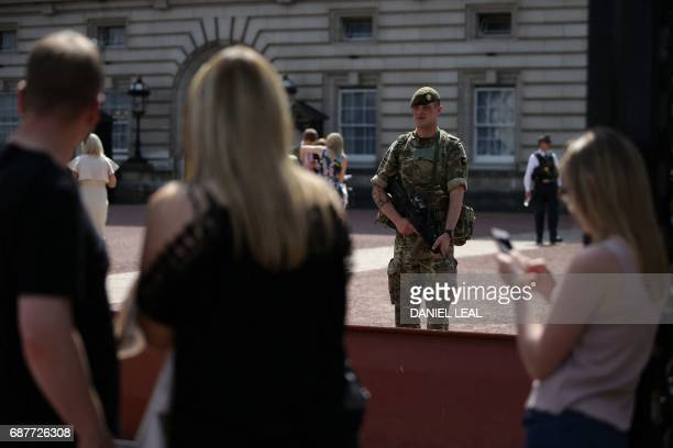 British Army soldier stands on duty at Buckingham Palace in central London on May 24 2017 Britain deployed soldiers to key sites Wednesday and raised...