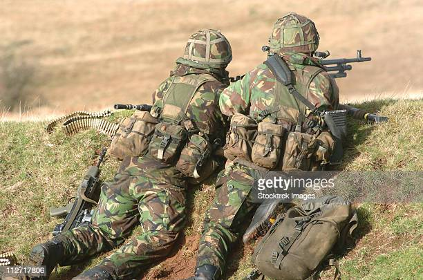 British Army soldiers armed with general purpose machine guns participate in sustained fire training at Brecon Beacons, South Wales.