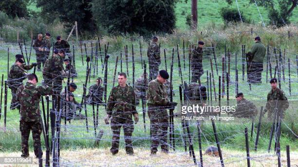 British Army soldiers erect barbed wire in the fields opposite Drumcree Church in the latest security measure put in place by the security forces...