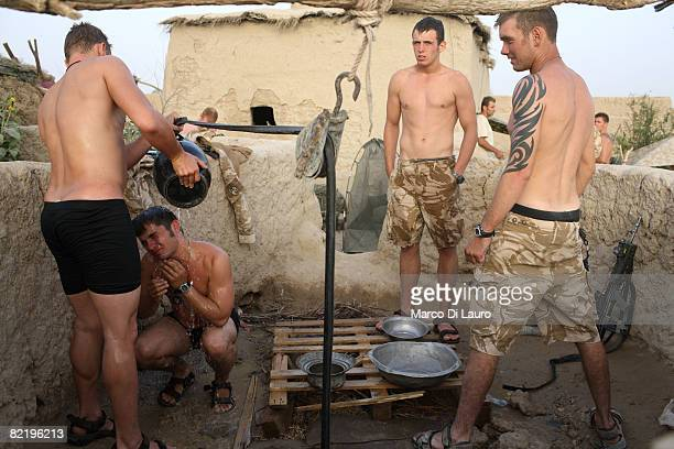British Army soldiers from the 3rd Battalion The Parachute Regiment wash themselves during operation Southern Beast on August 6 2008 in Maywand...