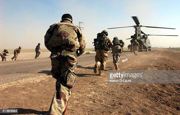 British Army soldiers from the Royal Welch Fusiliers Regiment and Iraqi National Guards reboard a Chinook Helicopter on September 26 2004 in Al...