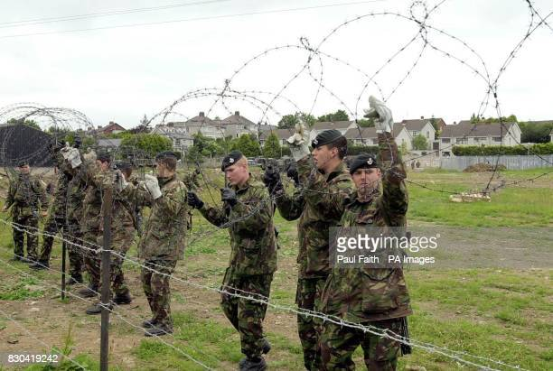 British Army soldiers of the Light Infantry erect barbed wire in the fields opposite Drumcree Church in the latest security measure put in place by...