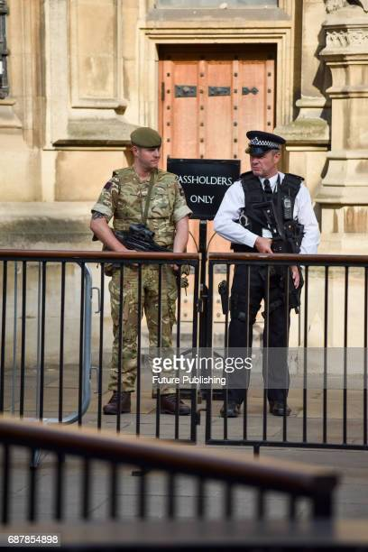 British Army soldiers seen on duty outside Parliament and Downing Street alongside armed police officers on May 24 2017 in London England PHOTOGRAPH...