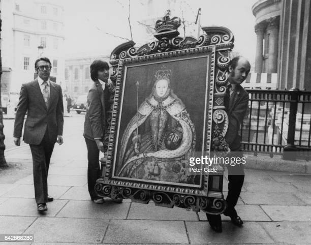 British art historian John Hayes Director of the National Portrait Gallery in London supervises the arrival of the only known portrait of Queen...