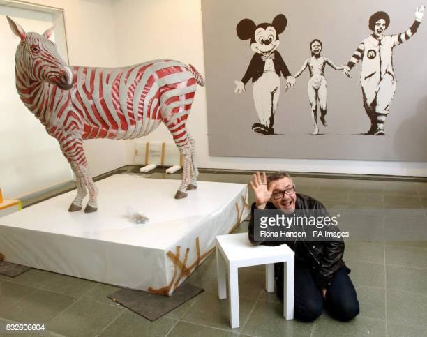 British artist Damien Hirst with some works from 'murderme' his personal contemporary art collection which he is exhibiting at London's Serpentine...