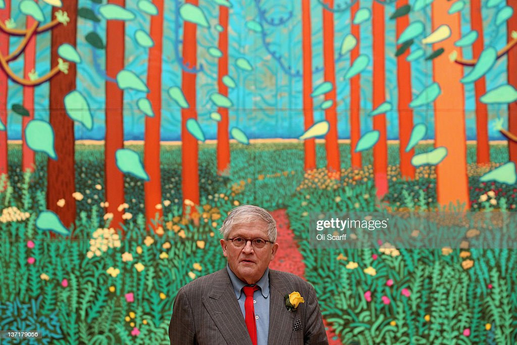 British artist David Hockney poses in front of his painting entitled 'The Arrival of Spring in Woldgate East Yorkshire in 2011 ' at the opening of...