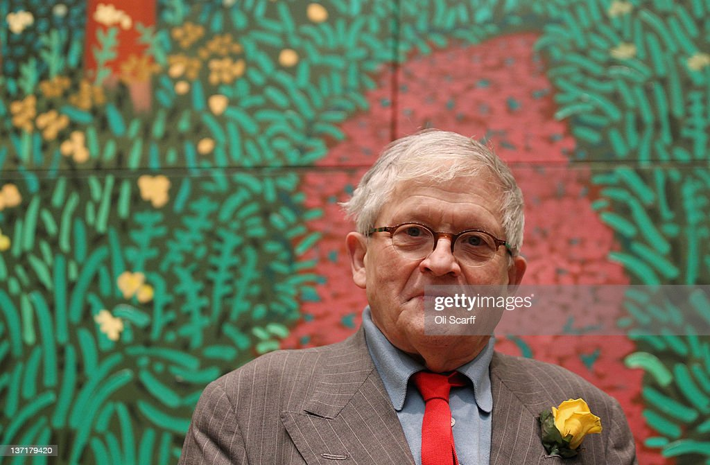 British artist David Hockney poses in front of his painting entitled 'The Arrival of Spring in Woldgate East Yorkshire 2011 ' at the opening of his...