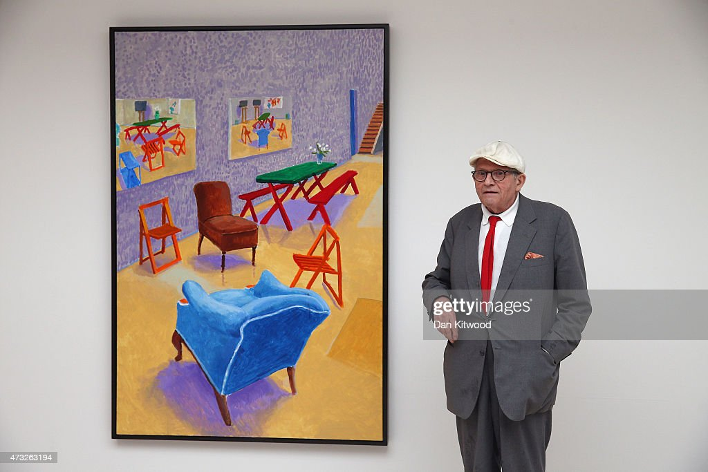 British artist David Hockney stands besides his painting entitled 'Studio Interior' during the launch of his new exhibition 'Paintings and...