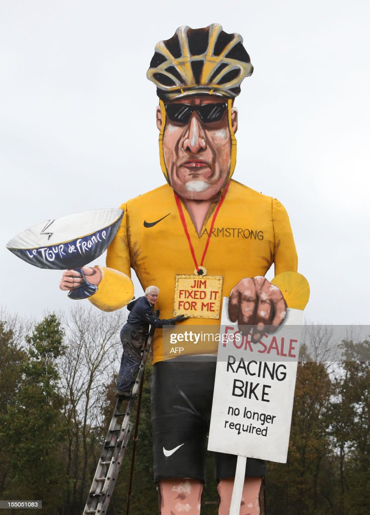 British artist Frank Shepherd of the Edenbridge Bonfire Society puts the finishing touches to a giant effigy of US cyclist Lance Armstrong in Edenbridge, Kent, southeast England, on October 31, 2012 which will be burnt over the weekend as a Guy during Bonfire Night. Stripped of his cycling medals over a doping scandal, disgraced US icon Lance Armstrong will suffer a fresh humiliation this weekend at the hands of an English town which will burn him in effigy. The 30-foot (nine-metre) steel-framed figure, dressed in a Tour de France leader's yellow jersey, will be torched on Saturday during the annual Guy Fawkes or Bonfire Night celebrations in Edenbridge.