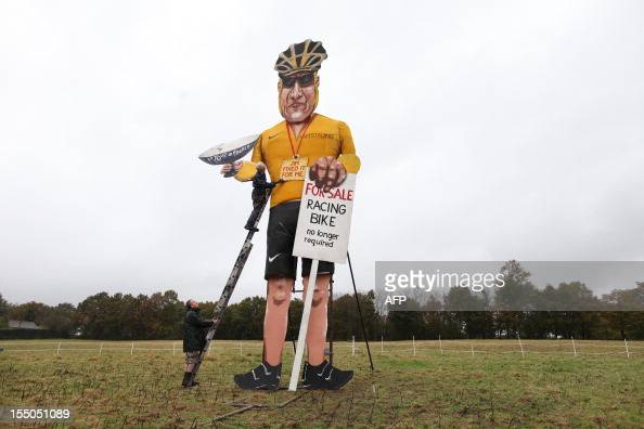 British artist Frank Shepherd of the Edenbridge Bonfire Society puts the finishing touches to a giant effigy of US cyclist Lance Armstrong in...