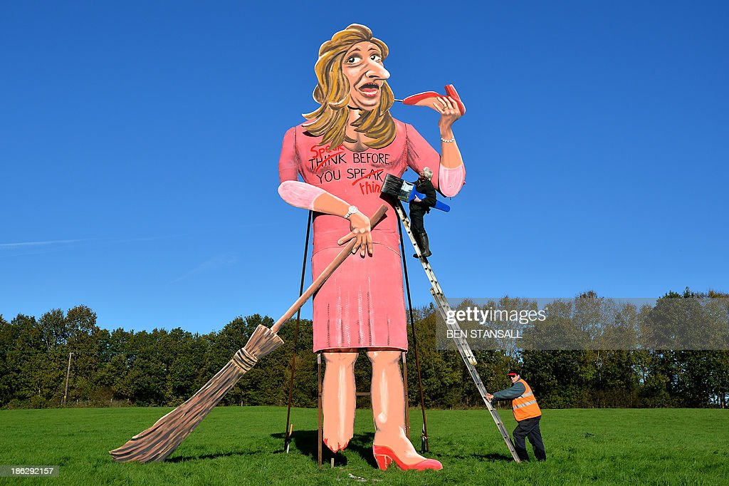 British artist Frank Shepherd of the Edenbridge Bonfire Society puts the finishing touches to a giant effigy of British former Apprentice contestant <a gi-track='captionPersonalityLinkClicked' href=/galleries/search?phrase=Katie+Hopkins&family=editorial&specificpeople=3297848 ng-click='$event.stopPropagation()'>Katie Hopkins</a> in Edenbridge, Kent, southeast England, on October 30, 2013, ahead of burning it as part of this years Bonfire Night celebrations.