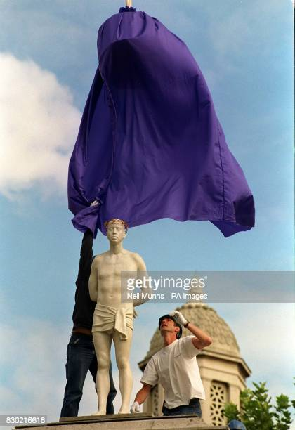 British artist Mark Wallinger oversees the unveiling of his statue Ecce Homo a contemporary lifesize figure of Christ at Trafalgar Square London the...
