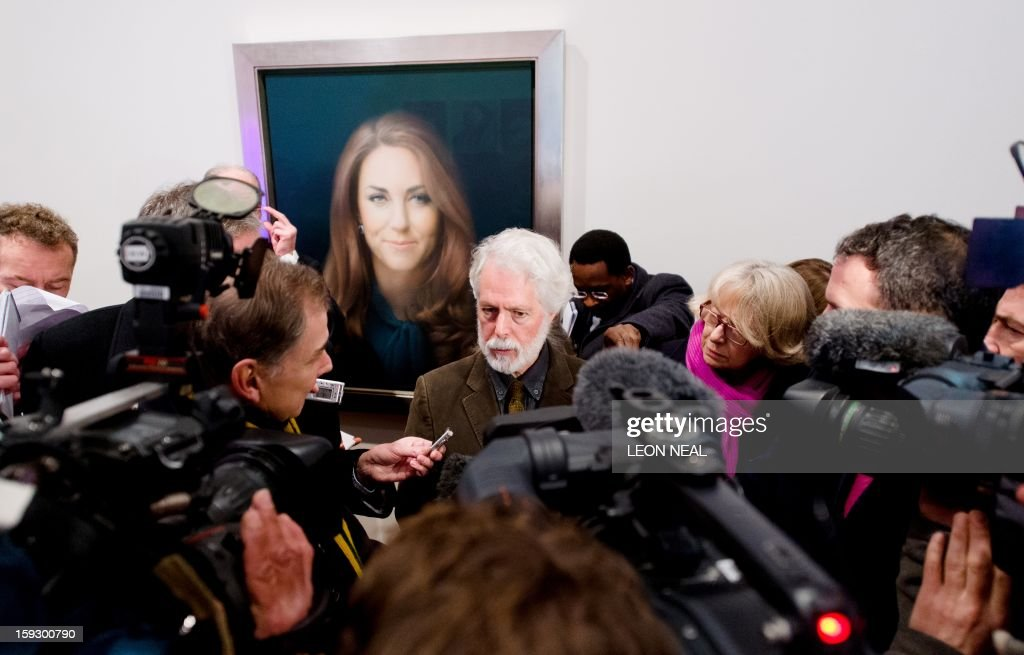 British artist Paul Emsley poses in front of his portrait of <a gi-track='captionPersonalityLinkClicked' href=/galleries/search?phrase=Catherine+-+Hertiginna+av+Cambridge&family=editorial&specificpeople=542588 ng-click='$event.stopPropagation()'>Catherine</a>, The Duchess of Cambridge after its unveiling at the National Portrait Gallery in central London on January 11, 2013. This is the first official portrait of the Duchess and was completed after two sittings at the artist's studio and Kensington Palace. AFP PHOTO/Leon NEAL - RESTRICTED TO EDITORIAL USE, MANDATORY MENTION OF THE ARTIST UPON PUBLICATION, TO ILLUSTRATE THE EVENT AS SPECIFIED IN THE CAPTION -