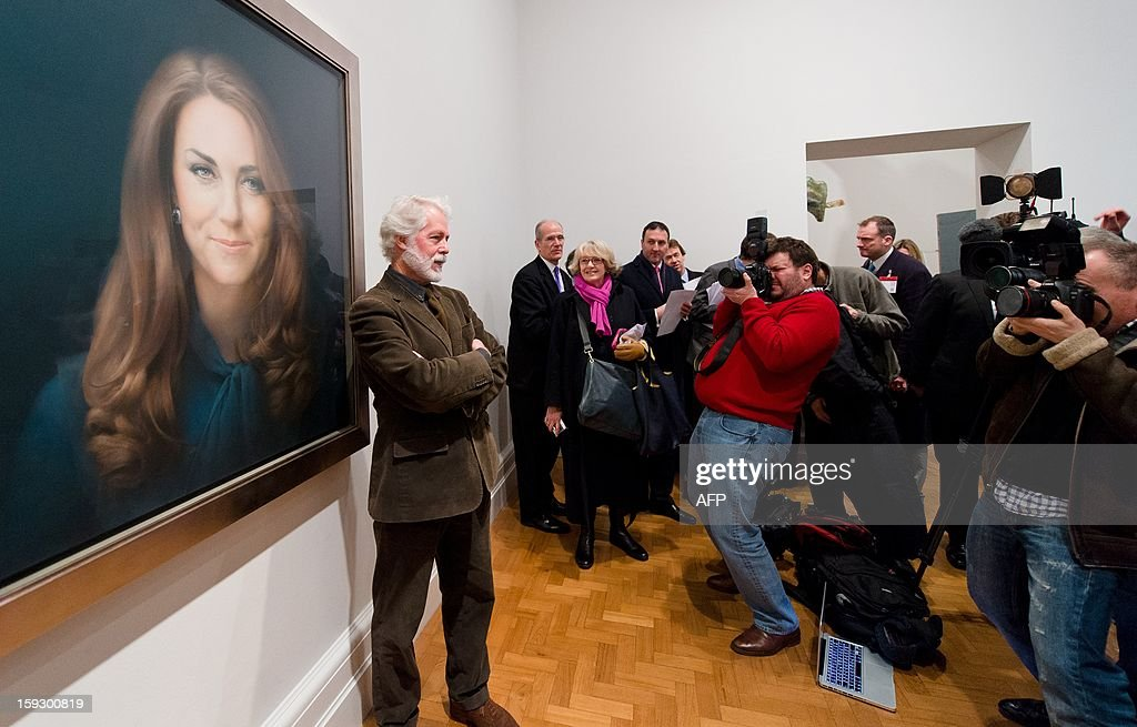 British artist Paul Emsley poses in front of his portrait of <a gi-track='captionPersonalityLinkClicked' href=/galleries/search?phrase=Catherine+-+Duchess+of+Cambridge&family=editorial&specificpeople=542588 ng-click='$event.stopPropagation()'>Catherine</a>, The Duchess of Cambridge after its unveiling at the National Portrait Gallery in central London on January 11, 2013. This is the first official portrait of the Duchess and was completed after two sittings at the artist's studio and Kensington Palace. AFP PHOTO/Leon NEAL - RESTRICTED TO EDITORIAL USE, MANDATORY MENTION OF THE ARTIST UPON PUBLICATION, TO ILLUSTRATE THE EVENT AS SPECIFIED IN THE CAPTION -