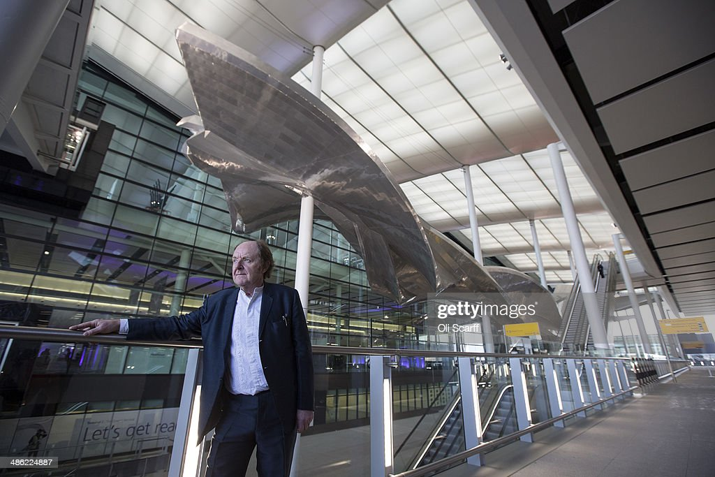British artist <a gi-track='captionPersonalityLinkClicked' href=/galleries/search?phrase=Richard+Wilson+-+Sculptor&family=editorial&specificpeople=14229439 ng-click='$event.stopPropagation()'>Richard Wilson</a> poses with his new artwork 'Slipstream' in Terminal 2 of Heathrow airport on April 23, 2014 in London, England. The aluminum artwork 'Slipstream' which is suspended 18 meters above the ground, weighs 77 tonnes and is 78 meters in length and is inspired by the flight path of a stunt plane. The rebuilding of Heathrow's Terminal 2 has taken five years at a cost of 2.5 billion GBP and will officially open to the public on June 23, 2014.