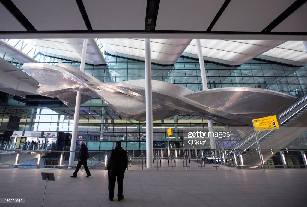 British artist Richard Wilson's new artwork 'Slipstream' in Terminal 2 of Heathrow airport on April 23, 2014 in London, England. The aluminum artwork 'Slipstream' which is suspended 18 meters above the ground, weighs 77 tonnes and is 78 meters in length and is inspired by the flight path of a stunt plane. The rebuilding of Heathrow's Terminal 2 has taken five years at a cost of 2.5 billion GBP and will officially open to the public on June 23, 2014.
