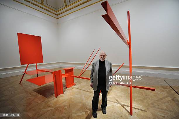 British artist Sir Anthony Caro poses for photographers with his sculpture entitled 'Early One Morning' during the launch of the 'Modern British...