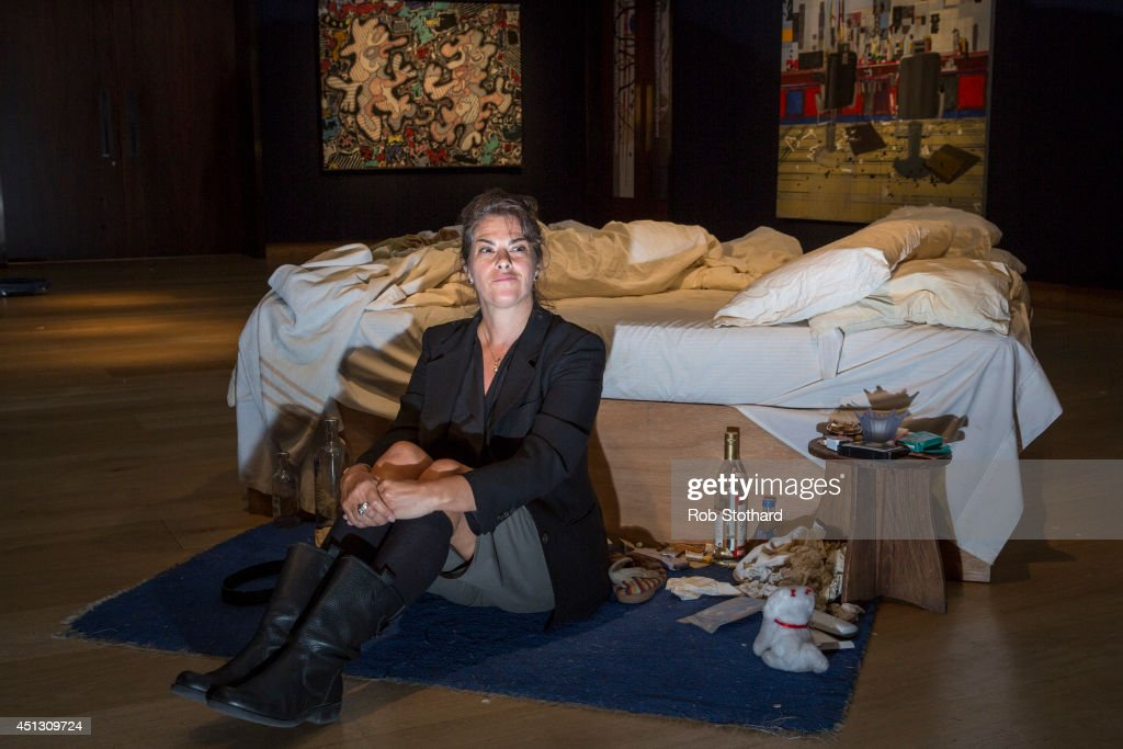 British artist Tracy Emin's sits in front of her 1998 piece 'My Bed' on display at Christie's on June 27 2014 in London England This iconic work from...