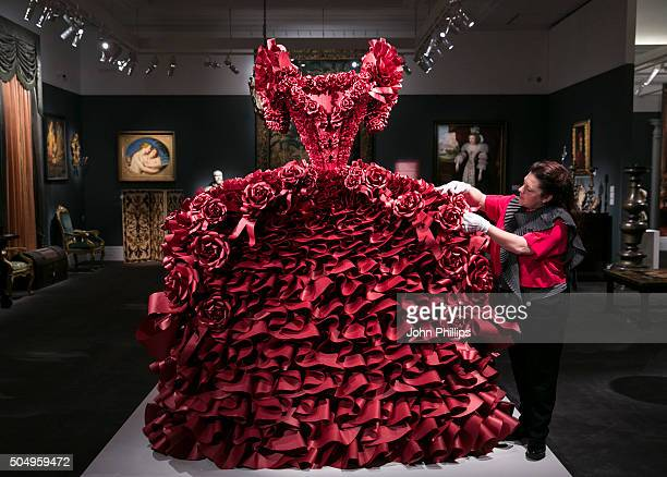 British Artist Zoe Bradle makes finishing touches to her monumental red paper dress sculpture containing 5940 ruffles at Sotheby's on January 14 2016...