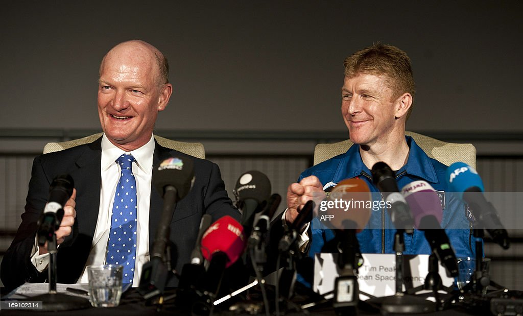 British astronaut Major Tim Peake (R) and Britain's Science Secretary David Willetts (L) attend a press conference at the Science Museum in central London on May 20th 2013, where it was announced Peake will be joining the International Space Station (ISS) in late 2015. A former army helicopter pilot was on May 20 named as the first 'home-grown' British astronaut to head to the International Space Station. Major Tim Peake, 41, will fly out to the ISS in November 2015 as part of a six-man crew, becoming the first Briton ever to travel to space on a British government-funded mission. AFP PHOTO / WILL OLIVER