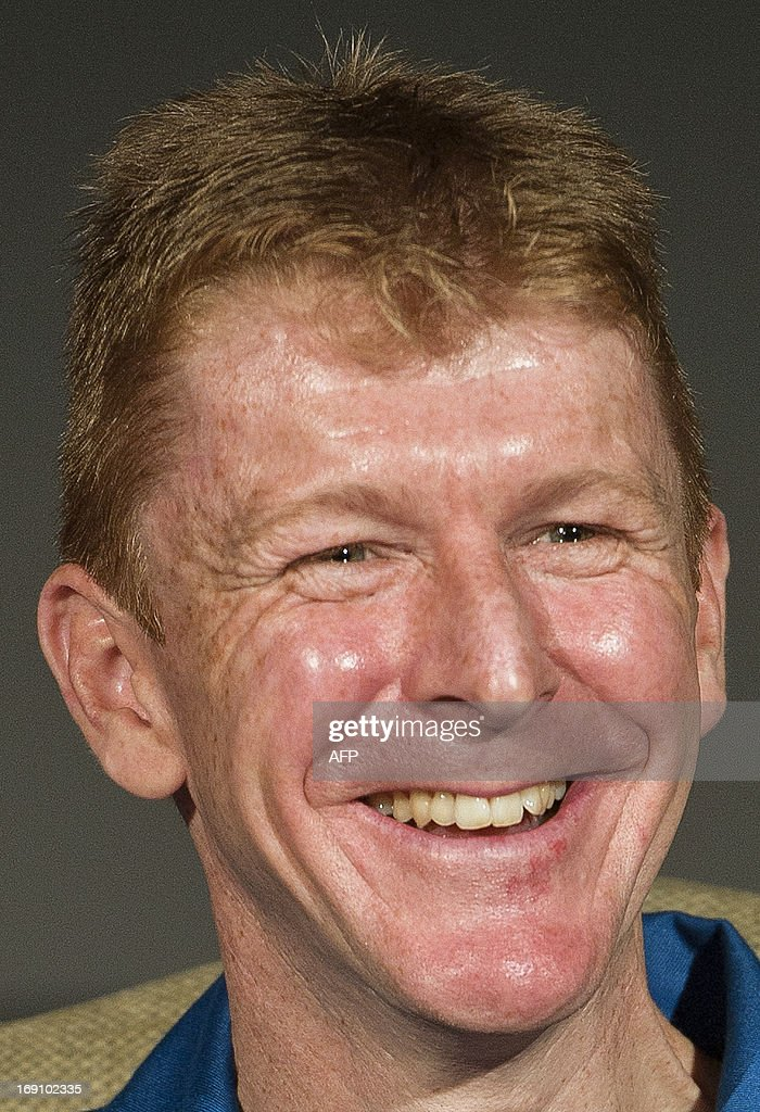 British astronaut Major Tim Peake smiles during a press conference at the Science Museum in central London on May 20th 2013, where it was announced he will be joining the International Space Station (ISS) in late 2015. A former army helicopter pilot was on May 20 named as the first 'home-grown' British astronaut to head to the International Space Station. Major Tim Peake, 41, will fly out to the ISS in November 2015 as part of a six-man crew, becoming the first Briton ever to travel to space on a British government-funded mission. AFP PHOTO / WILL OLIVER
